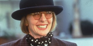 Portrait of American actor and director Diane Keaton, 1996. She wears a purple & black striped suit coat, bowler hat, and, around her neck, a large black crucifix (Photo by Fotos International/Getty Images)